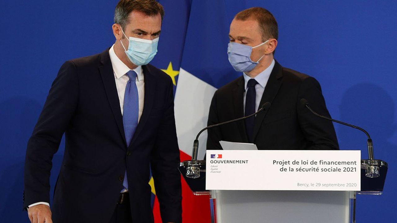 Les ministres Olivier Véran et Olivier Dussopt ont présenté ce mardi à Bercy le projet de loi de financement de la Sécurité sociale pour 2021.