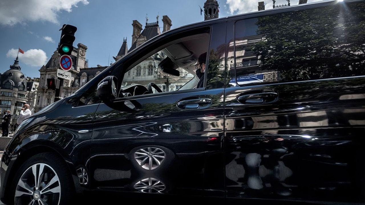 A Paris, quelque 20.000 chauffeurs de VTC se partagent le bitume, mais tous n'ont pas repris le volant avec la crise du Covid.