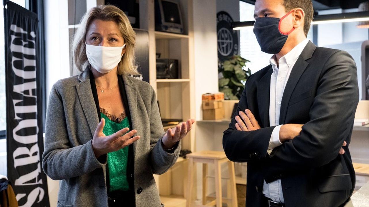 Barbara Pompili, la ministre de la Transition écologique, et Cédric O, le secrétaire d'Etat en charge de la Transition numérique, en visite début octobre chez le reconditionneur Back Market.