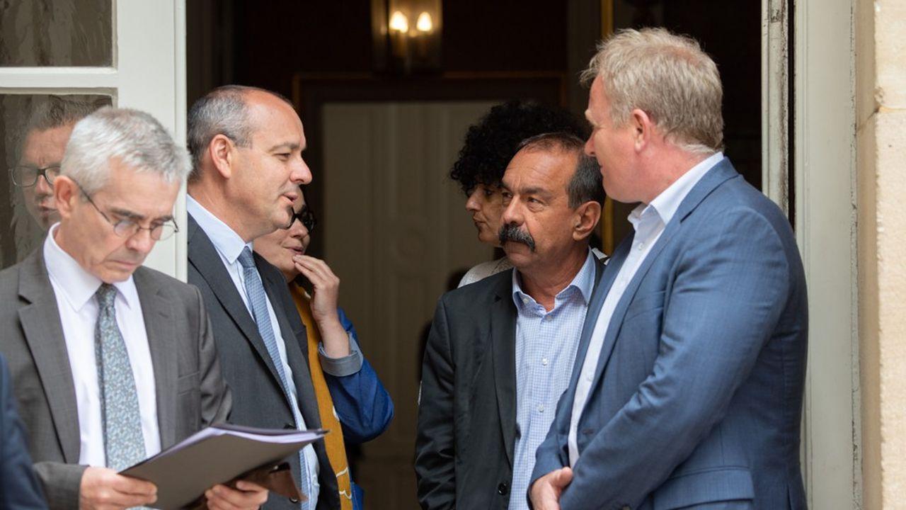 Yves Veyrier (FO), Laurent Berger (CFDT), Philippe Martinez (CGT) et François Hommeril (Cfe-Cgc) le 17juillet 2020, à la sortie du premier sommet social organisé par Jean Castex à Matignon.