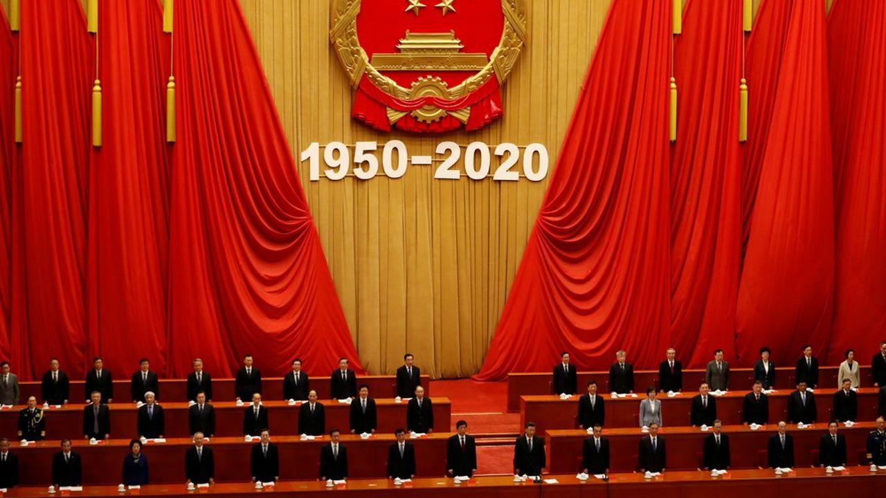 Le président chinois Xi Jinping et le Premier ministre Li Keqiang take participent dans la Grande salle du peuple à Pékin à une commémoration marquant le 70e anniversaire de la participation de l'Armée de volontaires chinois à la guerre de Corée.