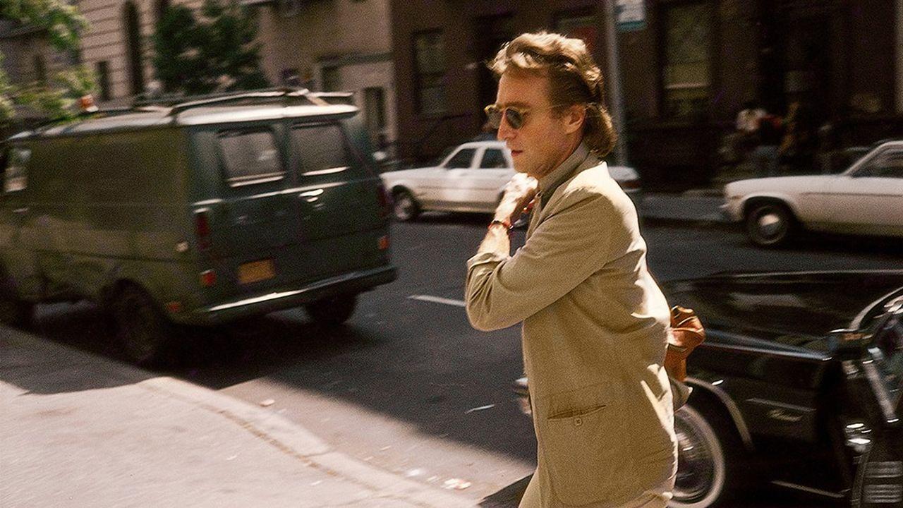 En 1980, John Lennon arrivant au 'Hit Factory', le studio ou il enregistrait son nouvel album après des années de silence.