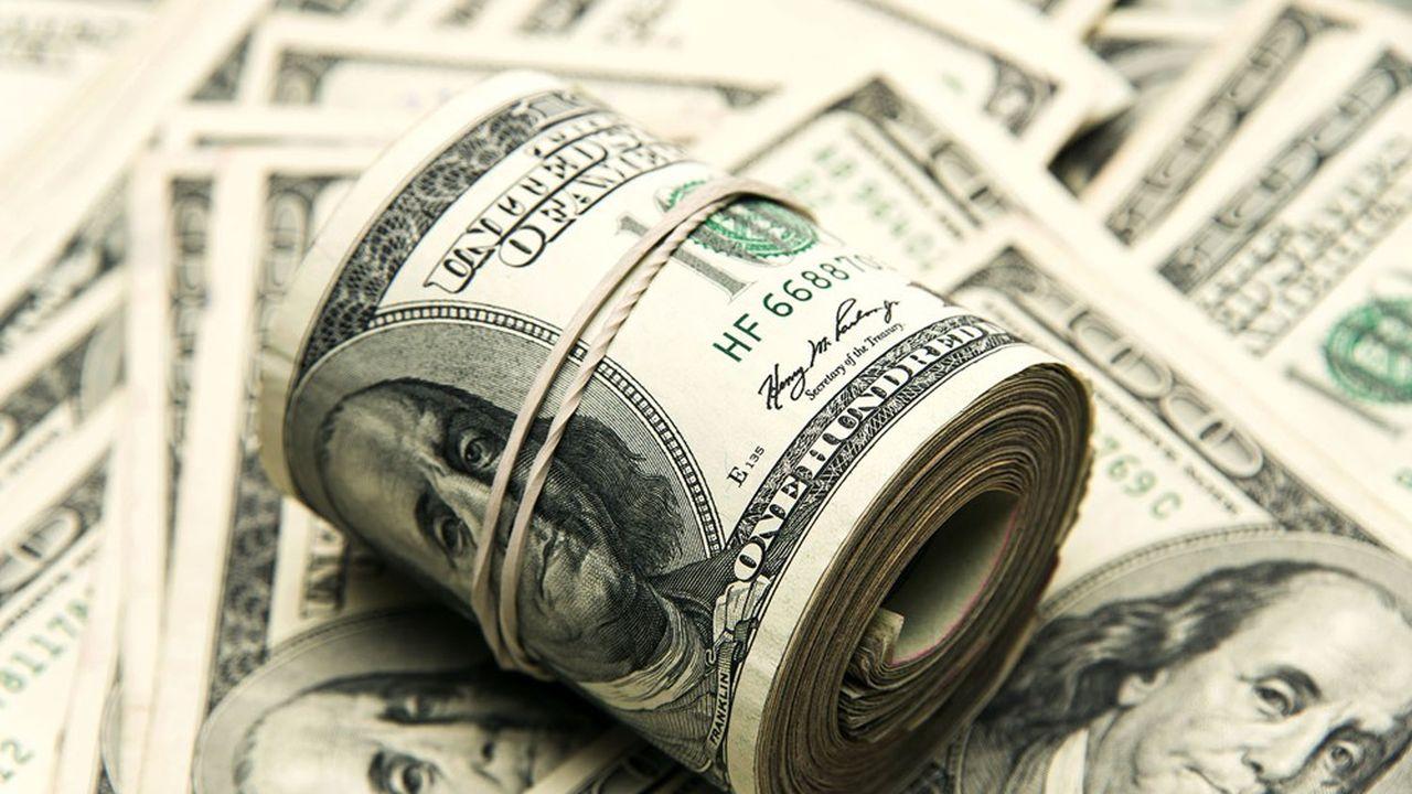 one hundred US dollar bills bundles