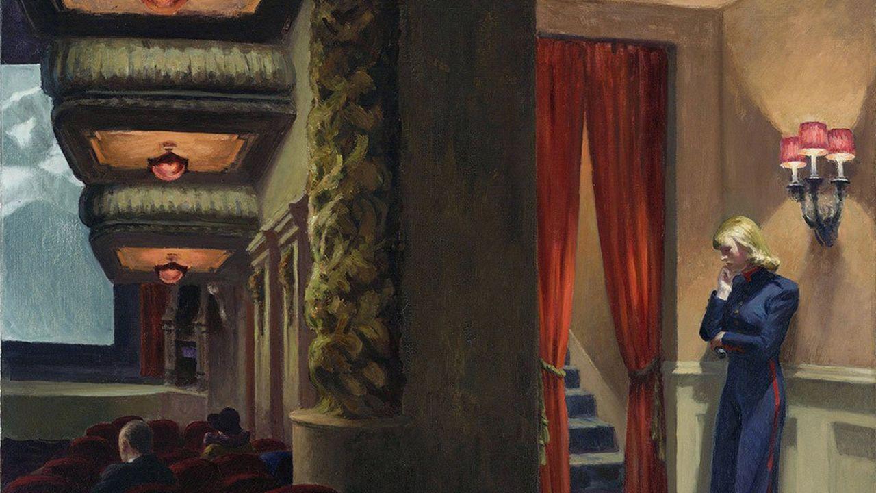 L'ouvreuse dans l'attente dans «New York Movie» (1939), peinture d'Edward Hopper.