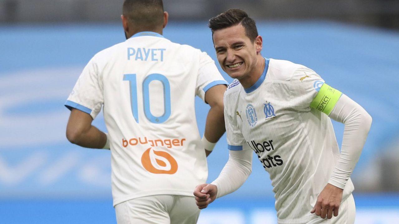 La LFP vient de lancer un appel d'offres pour les droits de diffusion des matchs professionnels de football. Ici, les joueurs marseillais Florian Thauvin et Dimitri Payet.