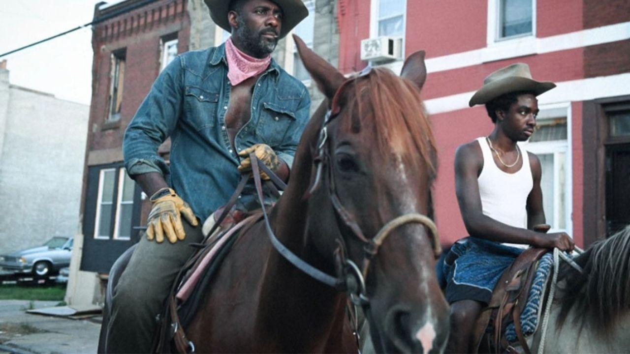 Idris Elba et Caleb McLaughlin chevauchent à travers les rues de Philadelphie dans «Concrete Cowboy».