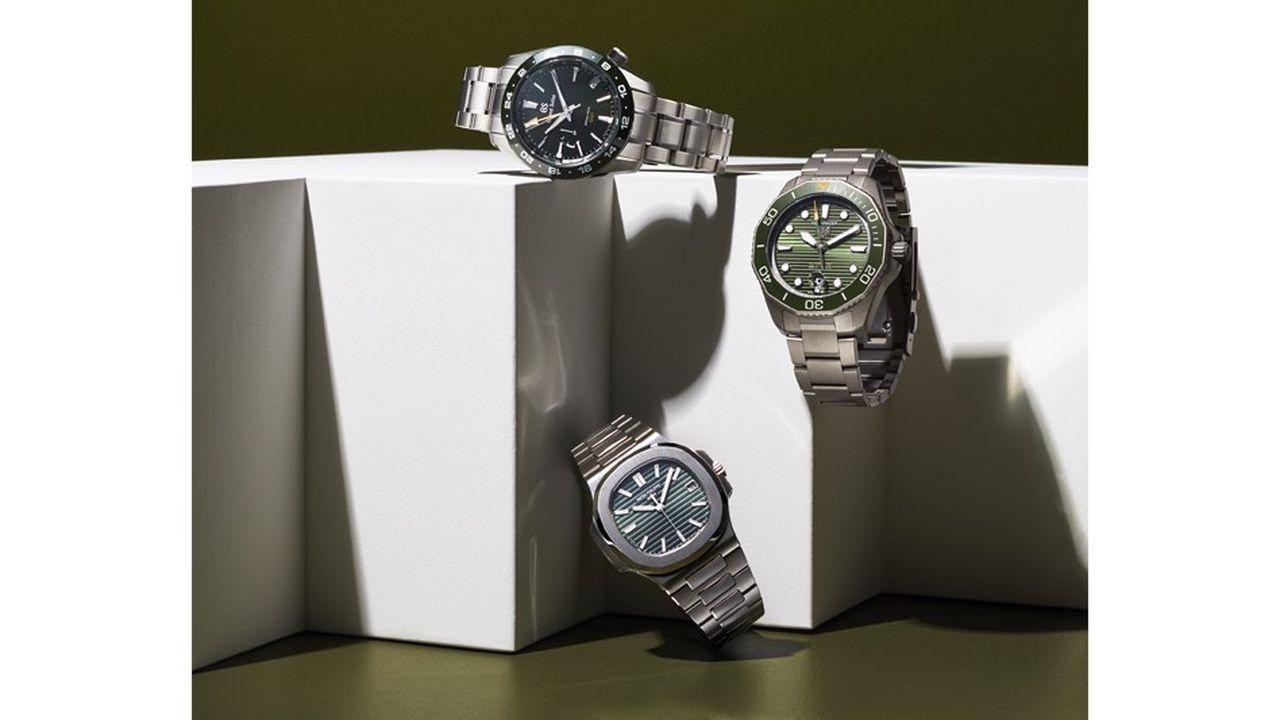 Trois montres couleur vert.