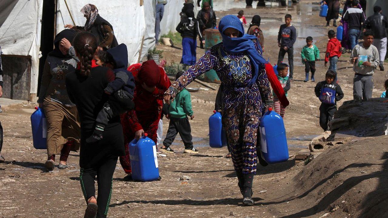 Des réfugiés syriens dans un camp au Liban. La Syrie est le premier pays d'origine des réfugiés dans le monde.
