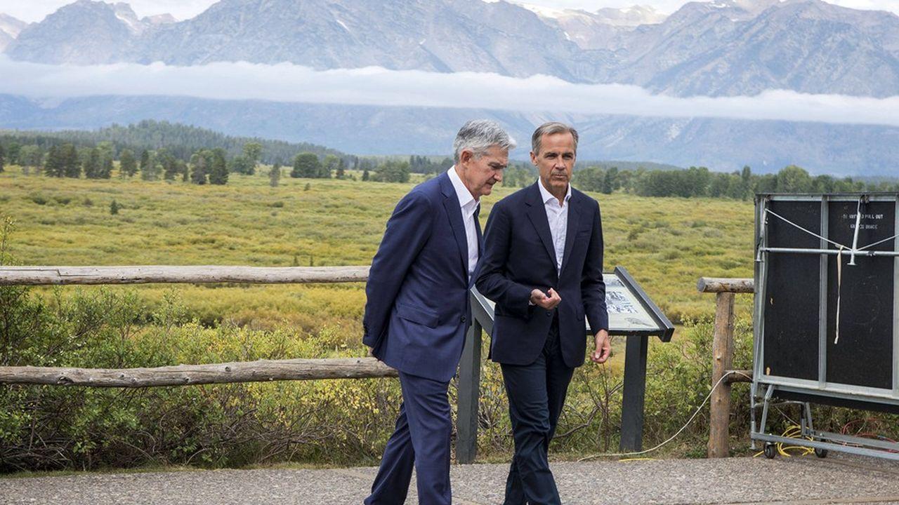 Jerome Powell, le président de la Réserve fédérale et son homologue anglais Mark Carney lors de la dernière réunion de Jackson Hole en présentiel en août2019, avant la pandémie mondiale.