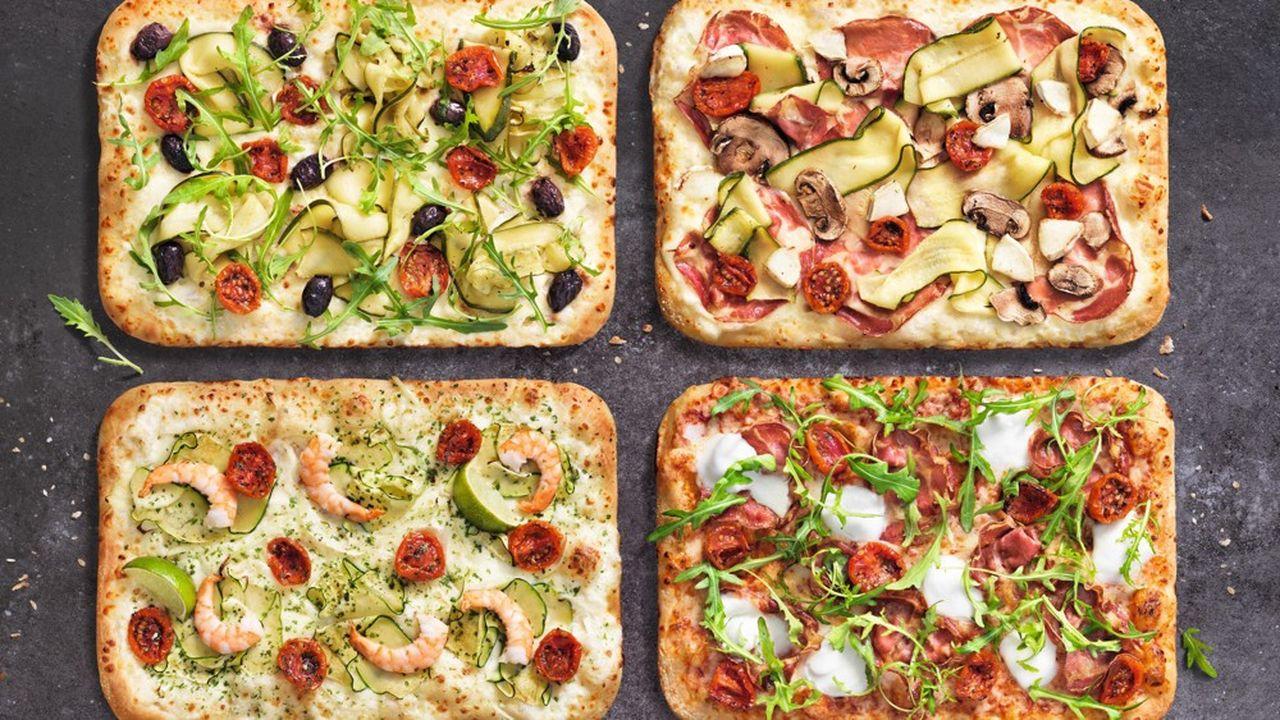 Premium, cuite différemment, la nouvelle gamme Signatures de Domino's Pizza utilise des ingrédients comme de la coppa di Parma IGP ou de l'huile d'olive AOP Kalamata.
